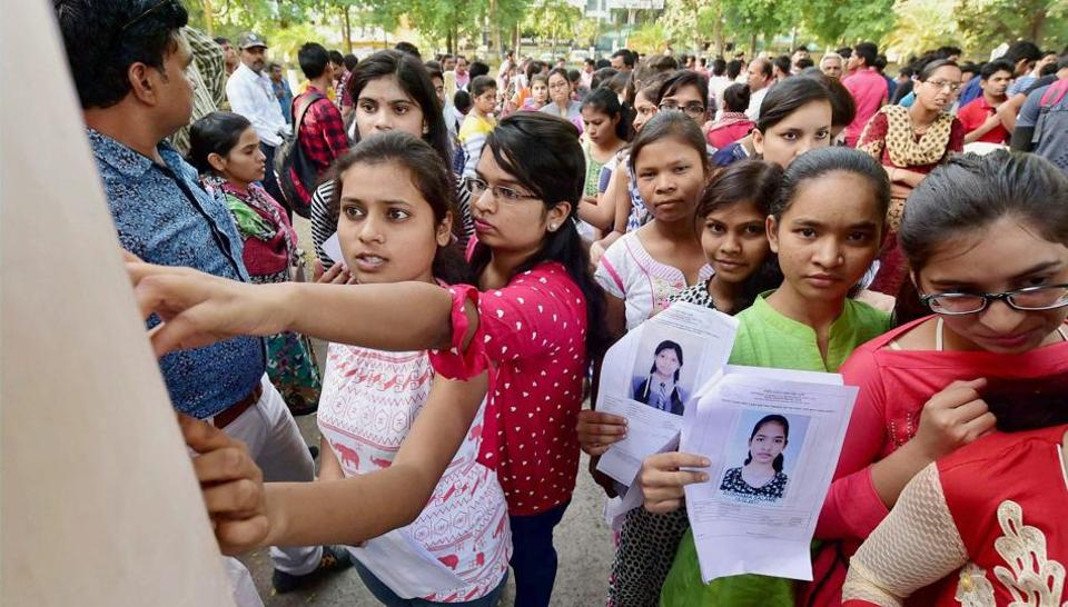 Aspirants check seating arrangements before a NEET examination in Bhopal recently. The petition filed in the Supreme Court alleged that the new system favours urban students over rural ones.