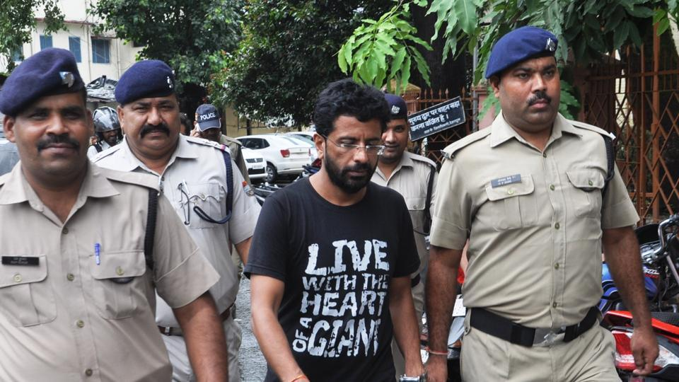 Rajesh Gulati being brought on Friday to a court in Dehradun where he was given a life sentence for the murder of his wife.