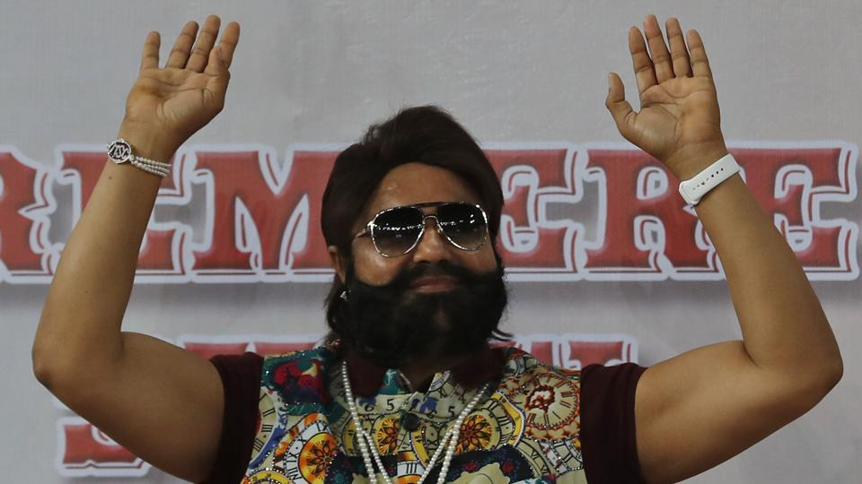 Gurmeet Singh Ram Rahim Insan, gestures during the premiere of the