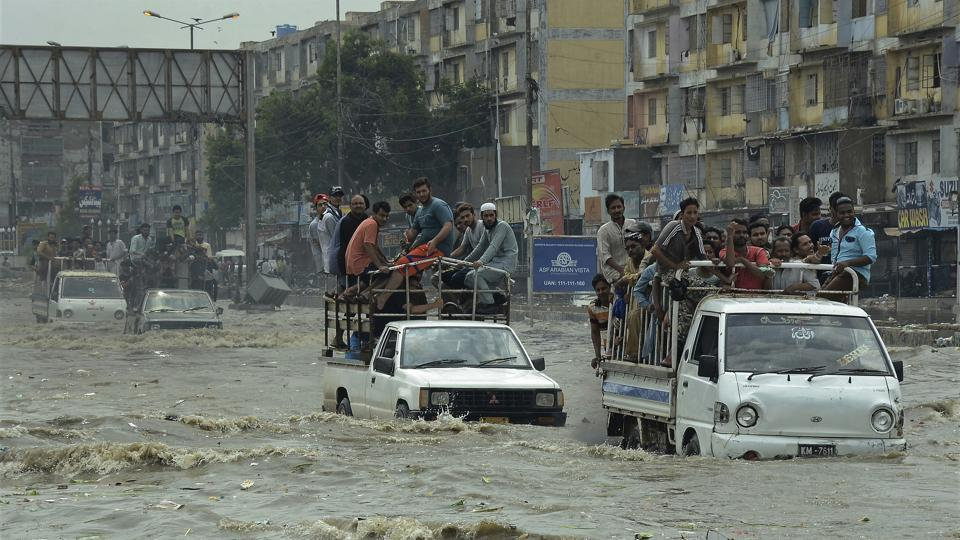 Pakistani commuters travel on a flooded street following heavy rainfall in the port city of Karachi on August 31, 2017. Monsoon rains in Karachi left at least 23 people dead in flood-related mishaps. The destruction came on the heel of downpours since Wednesday.