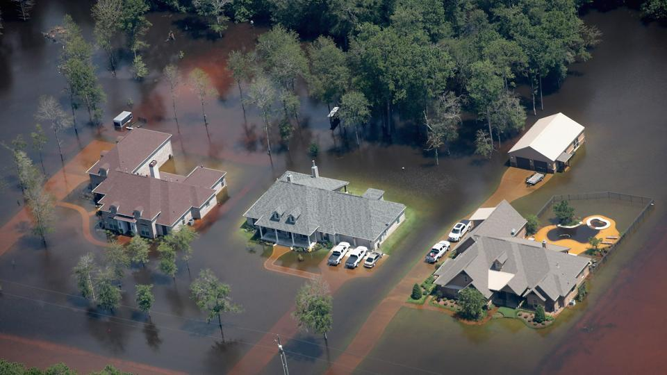 Homes are surrounded by floodwater after torrential rains pounded Southeast Texas following Hurricane and Tropical Storm Harvey on August 31, 2017 in Orange, Texas.