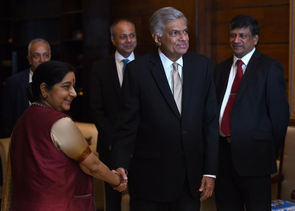 Sri Lanka's Prime Minister Ranil Wickremesinghe (right) shakes hands with external affairs minister Sushma Swaraj during the opening of the two-day Indian Ocean Conference 2017 in Colombo on August 31, 2017.