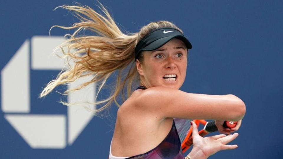 Ukraine's Elina Svitolina returns the ball to Russia's Evgeniya Rodina. (AFP)