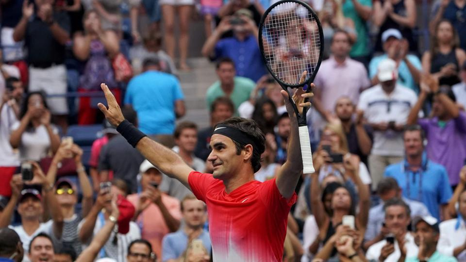Switzerland's Roger Federer celebrates after defeating Mikhail Youzhny at US Open. (AFP)