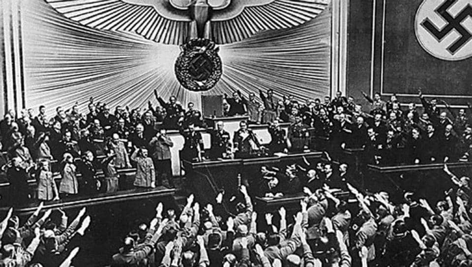 "German Nazi chancellor Adolf Hitler (centre) receives an ovation from the Reichstag and members of parliament who give him the nazi salute, for the ""Anschluss"" with Austria, the"