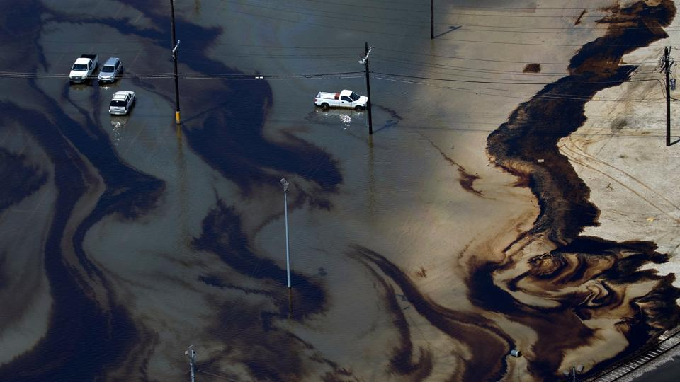 Vehicles sit amid leaked fuel mixed in with flood waters caused by Tropical Storm Harvey in the parking lot of Motiva Enterprises LLC in Port Arthur, Texas. Flooding from tropical storm Harvey shut nearly a fifth of US oil refining capacity with at least 3.6 million barrels per day of refining capacity offline in Texas and Louisiana, or nearly 20% of total US capacity as per company reports and Reuters estimates.  (Adrees Latif / REUTERS)