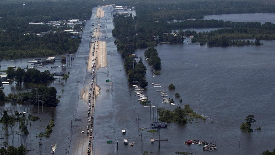 Vehicles on Interstate 10 navigate through flood waters caused by Tropical Storm Harvey in Texas, U.S. According to Department of Homeland Security some 779,000 Texans have been told to leave their homes and another 980,000 fled voluntarily amid dangers of new flooding from swollen rivers and reservoirs. (Adrees Latif  / REUTERS)