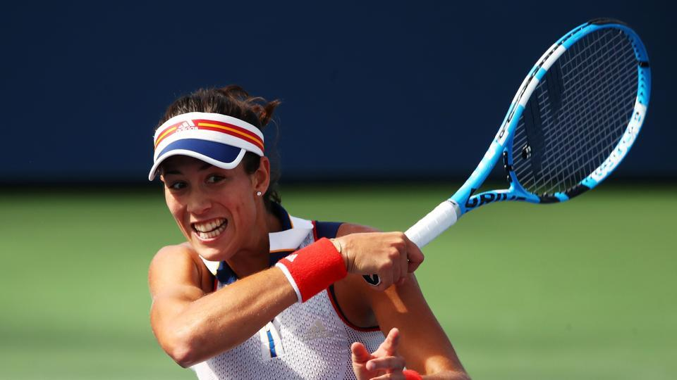 Garbine Muguruza of Spain continued her great run at the US Open with a win over Magdalena Rybarikova of Slovakia. (AFP)