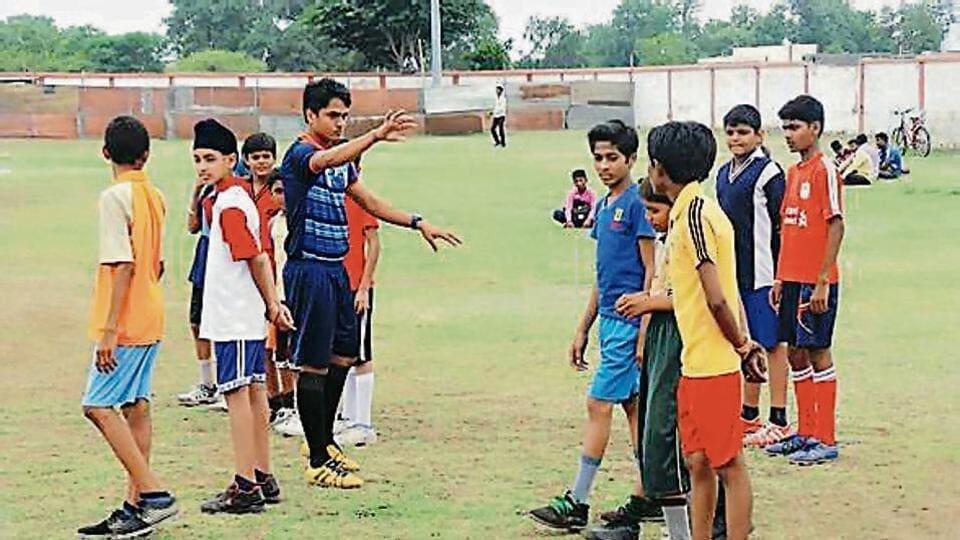 Football coach Surendra Sharma with the kids.