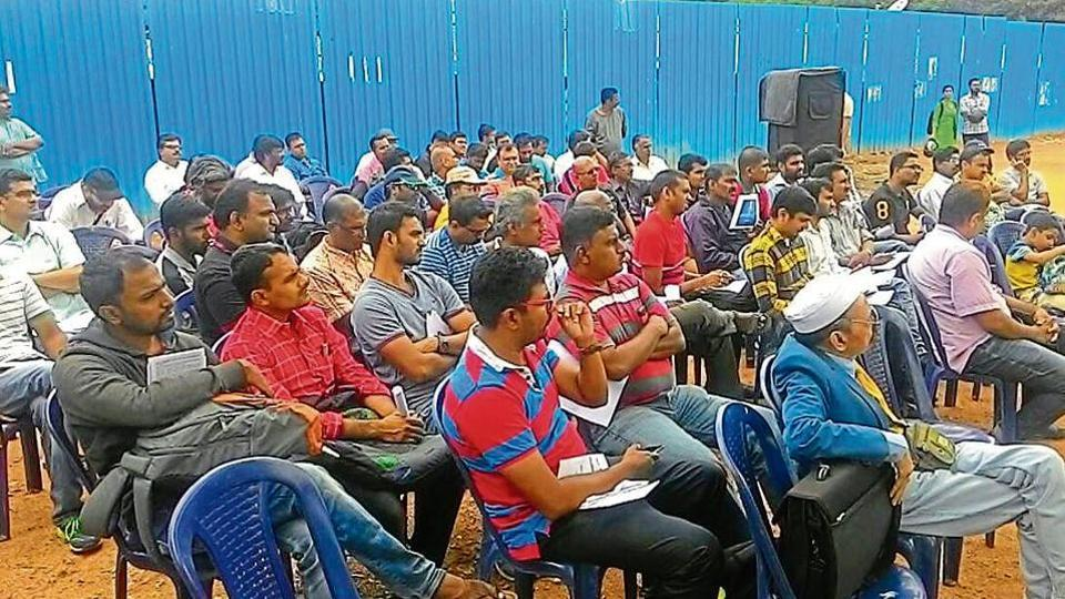 IT workers gather for a protest against layoffs in Bengaluru.