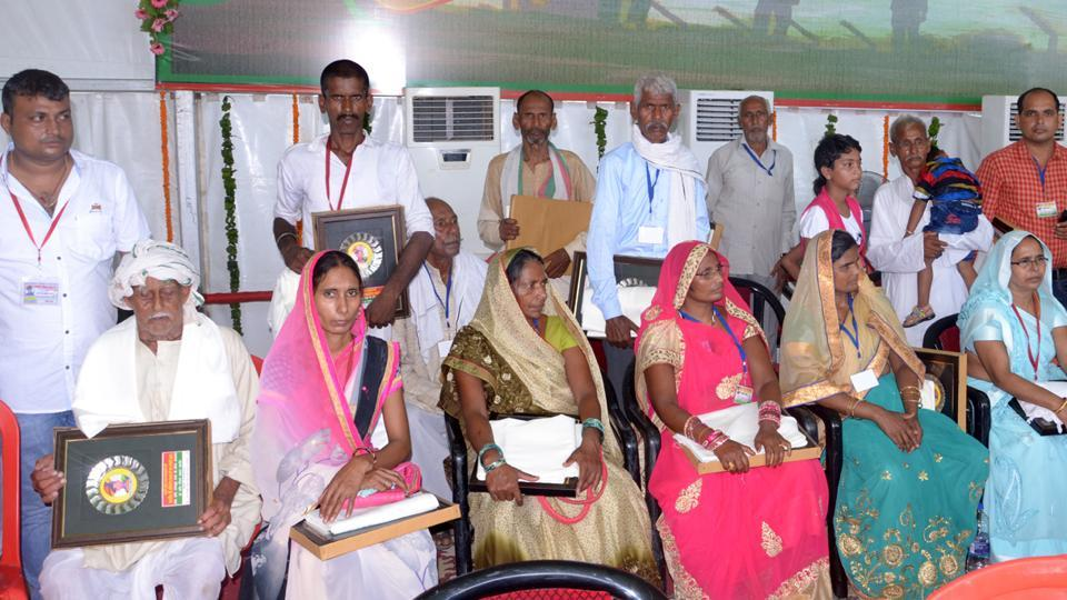 Kin of martyred soldiers with mementoes presented by Samajawadi Party president and former Uttar Pradesh chief minister Akhilesh Yavav at a function inAzamgarh.