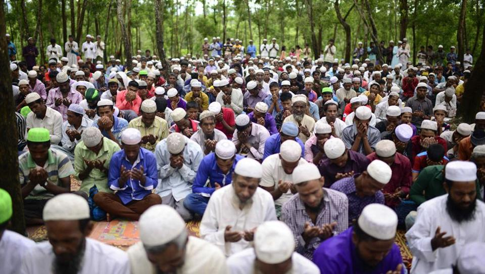 Rohingya refugees offer Eid prayer at Kutupalong refugee camp in Ukhiya near the Bangladesh-Myanmar border on September 2, 2017. Rohingya refugees marked Eid on September 2 with feasts and prayers in Bangladesh's Cox's Bazar after deadly communal violence in neighbouring Myanmar.