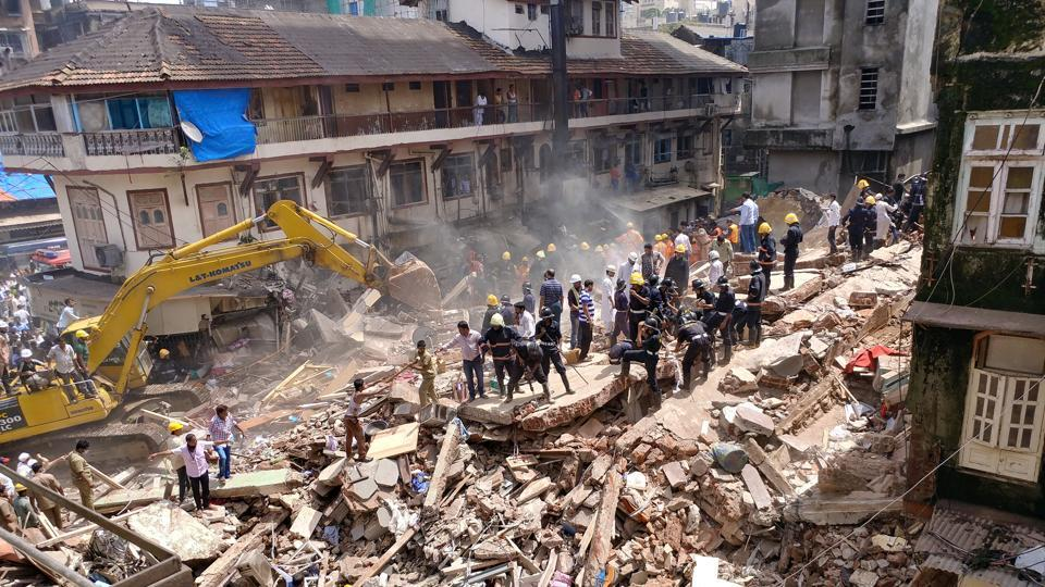 Firefighters and rescue workers search for survivors at the site of a collapsed building in Mumbai, India. (Shailesh Andrade  / REUTERS)