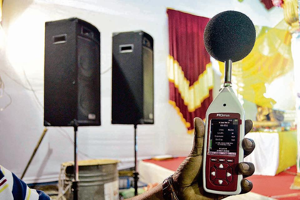 Police officials check noise levels of sound using a Decibel metre.