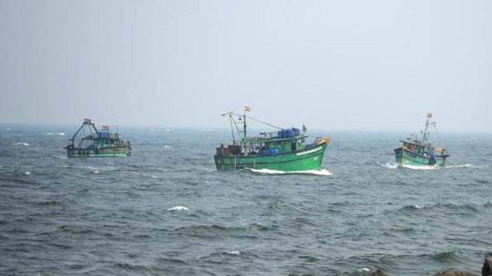 Indian fishermen return to harbour in Chennai on November 30.