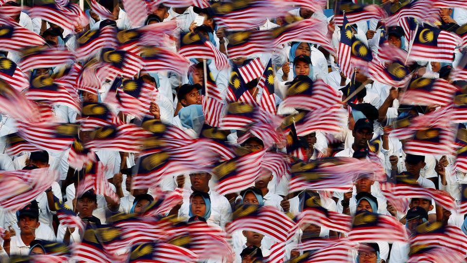 Performers hold up flags during the 60th Merdeka Day (Independence Day) celebrations in Kuala Lumpur, Malaysia. (Lai Seng Sin  / REUTERS)