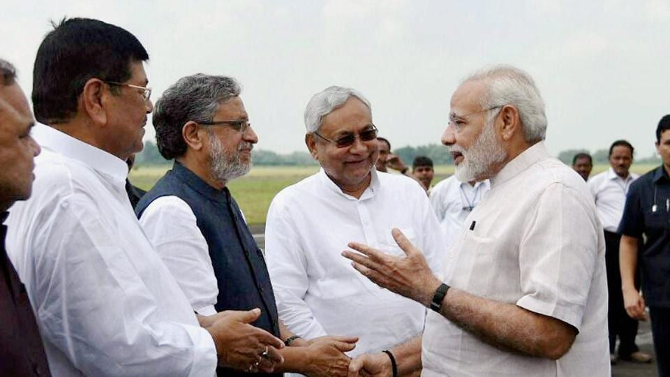 Prime Minister Narendra Modi with Bihar chief minister Nitish Kumar and deputy chief minister Sushil Kumar Modi at Paurnea Airport .