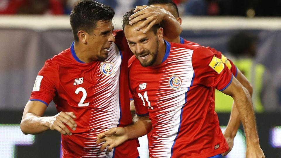 Costa Rica forward Marco Urena (21) celebrate with defender Johnny Acosta (2) after scoring a goal against USA.