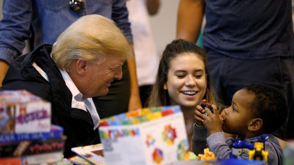 US President Donald Trump visits with survivors of Hurricane Harvey at a relief centre in Houston, Texas on September 2.