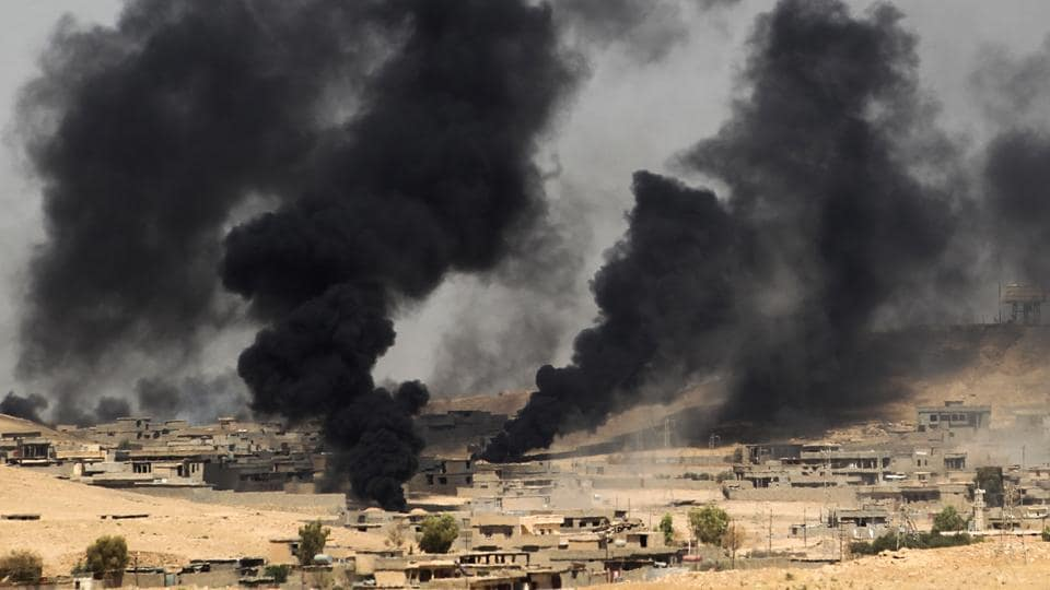 Smoke billows from the village of al-Ayadieh, near Qubuq, north of Tal Afar, as Iraqi forces advance during the ongoing operation to retake the area from the Islamic State (IS) group on August 28, 2017. Some of IS fighters inside Tal Afar were believed to have fled to Al-Ayadieh, located on the road between the city and the Syrian border, where they appeared to be making a desperate last stand.  (Ahmad al-Rubaye / AFP)