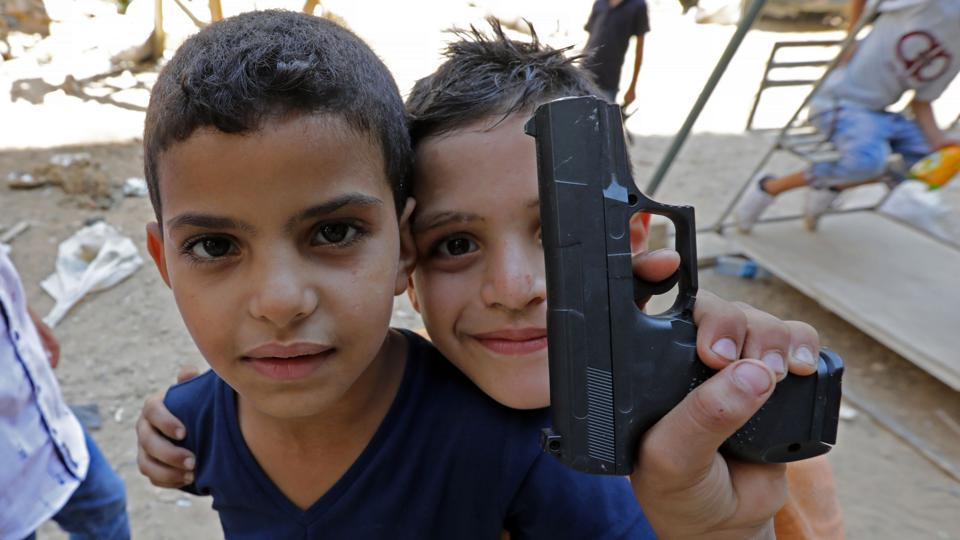 Syrian refugee children poses for a photo as they play on a street in the Palestinian Shatila refugee camp, on the southern outskirts of the Lebanese capital Beirut, on September 1, 2017, as Muslims mark the first day of the Eid al-Adha holiday. Muslims across the world celebrate the annual festival of Eid al-Adha, or the festival of sacrifice, which marks the end of the Hajj pilgrimage to Mecca and commemorates prophet Abraham's readiness to sacrifice his son to show obedience to God.  (ANWAR AMRO / AFP)