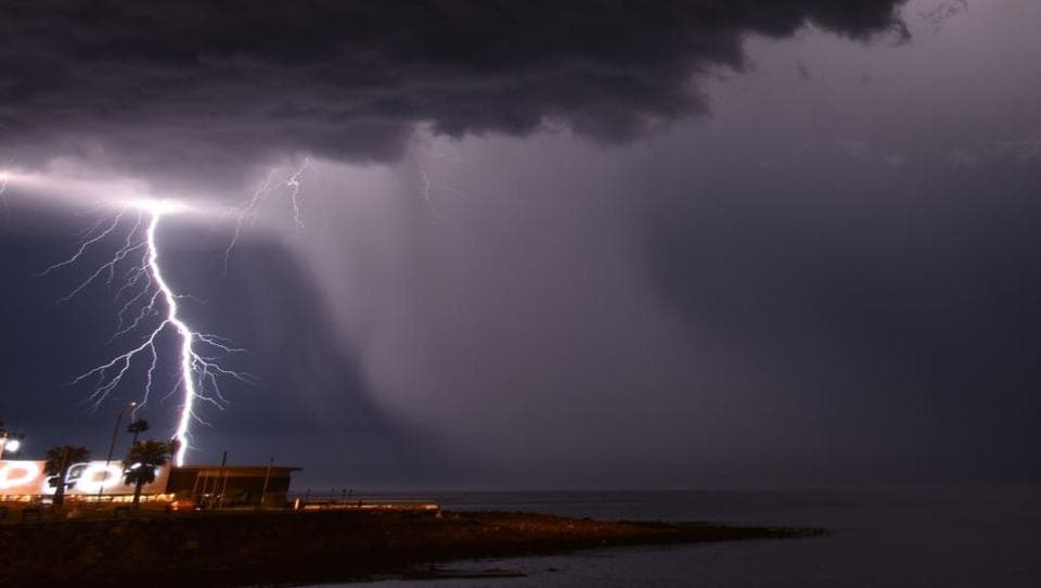 Lightning strikes off the coast of Montevideo. Following days of heavy rains, flooding in Uruguay has forced almost 900 people to flee their homes, authorities said Monday. Flooding in the country has grown increasingly common.  (Mariana SUAREZ / AFP)