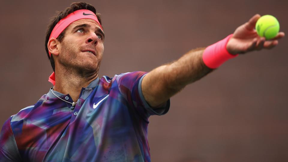 Juan Martin del Potro of Argentina serves to Roberto Bautista Agut of Spain in their third round match. (AFP)
