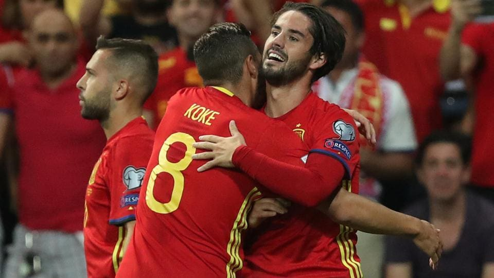 Spain's Isco celebrates scoring their first goal with Koke during their FIFA World Cup Qualifier against Italy.