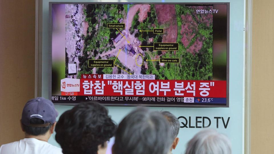 People in Seoul watch a TV news report on a possible nuclear test conducted by North Korea.
