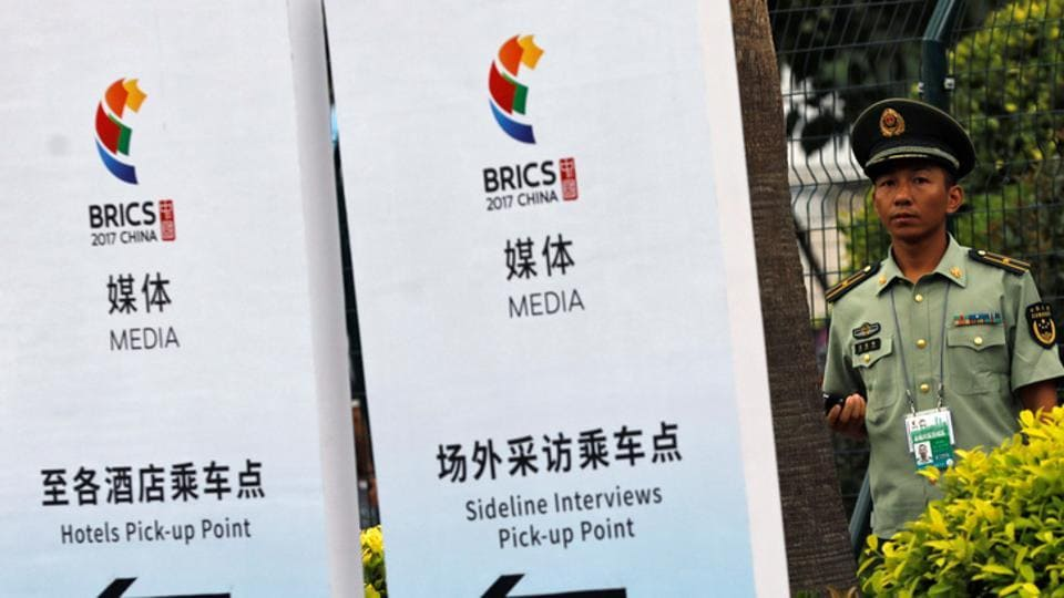 A paramilitary police officer stands outside the media center of BRICS (Brazil, Russia, India, China and South Africa) Summit in Xiamen, China September 2, 2017.