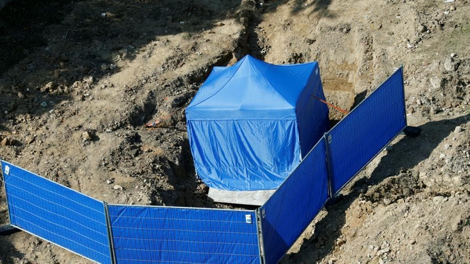 A tent covers the area around an unexploded British World War Two bomb which was found during renovation work on the university's campus in Frankfurt, Germany.