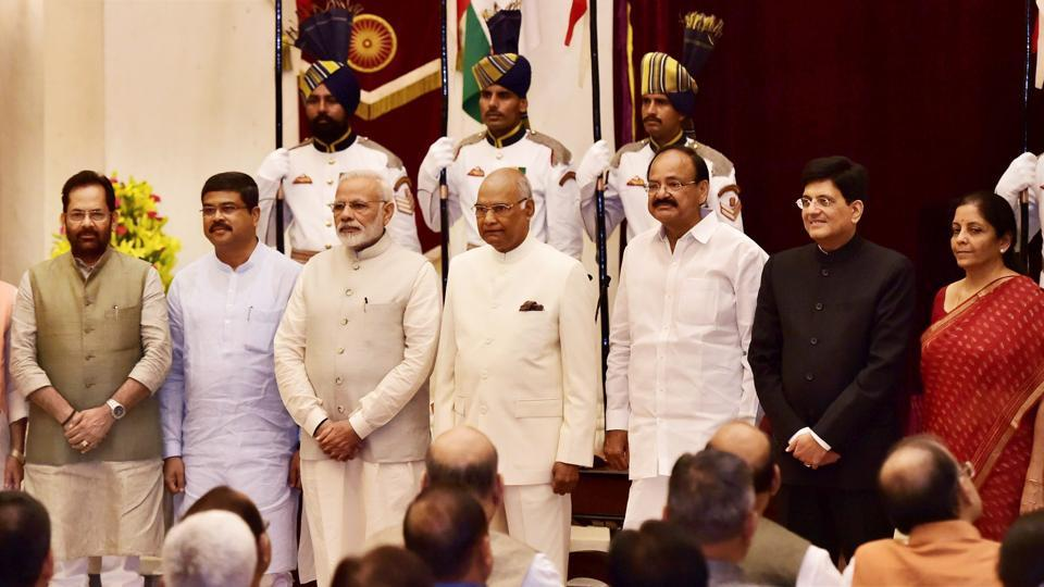 President Ram Nath Kovind, vice president  Venkaiah Naidu, Prime Minister Narendra Modi pose with new Cabinet ministers after the reshuffle at Rashtrapati Bhavan in New Delhi on Sunday. None of the BJPallies made it to the council of ministers.
