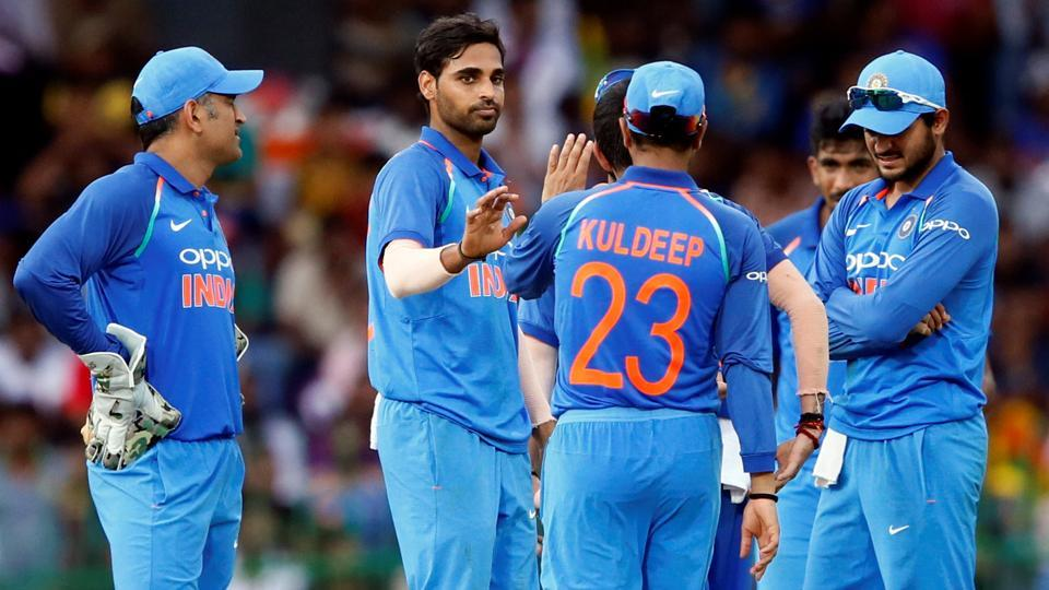 Bhuvneshwar Kumar celebrates with Indian cricket teammates after taking the wicket of Sri Lanka's Lahiru Thirimanne in the fifth ODI on Sunday.