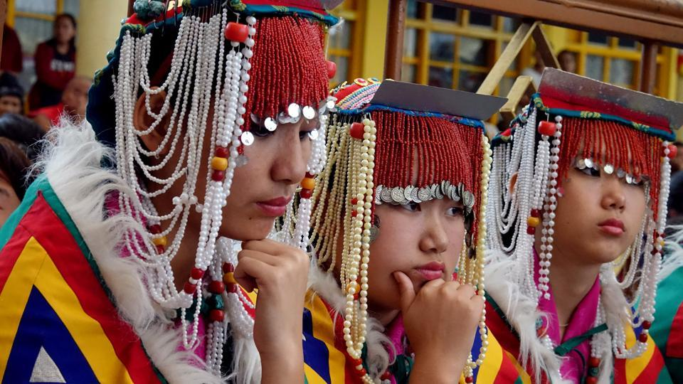 Students of the Upper TCV School in traditional costumes, waiting for their turn to perform on the occasion of the 57th Tibetan Democracy Day in main Tibtan temple in Mcleodganj near Dharamsala . (Shyam Sharma / HT photo)