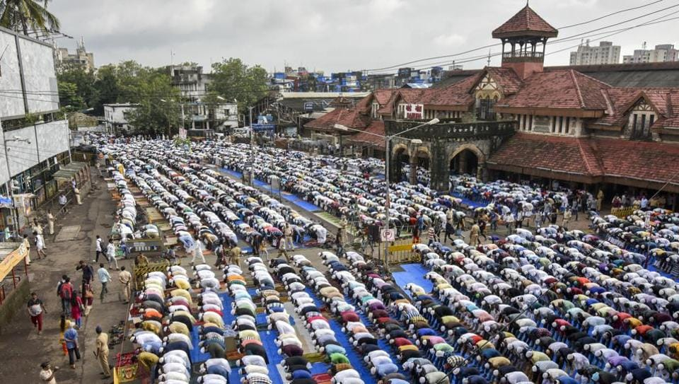 Muslims pray on the  occasion of Bakri Eid outside Bandra station in Mumbai on Saturday.