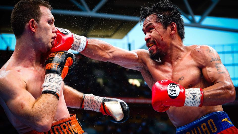 Manny Pacquiao (R) of the Philippines fighting Jeff Horn (L) of Australia during their World Boxing Organization (WBO).