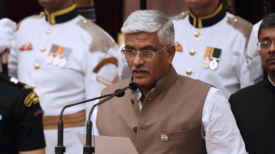 Bhartiya Janata Party politician Gajendra Singh Shekhawat takes the oath during the swearing-in ceremony of new ministers at the Presidential Palace in New Delhi on Sunday.