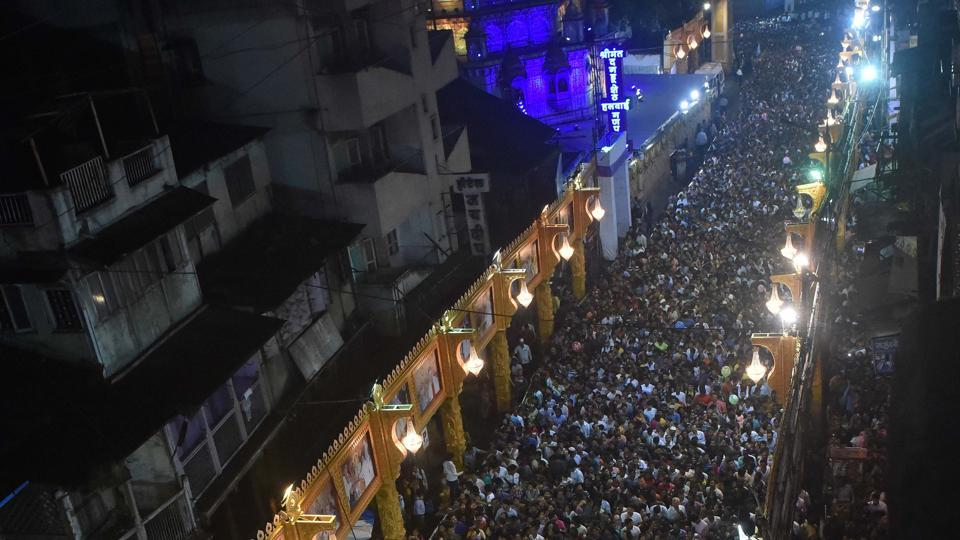 Road filled with devotees during the ongoing Ganesh festival in Pune.