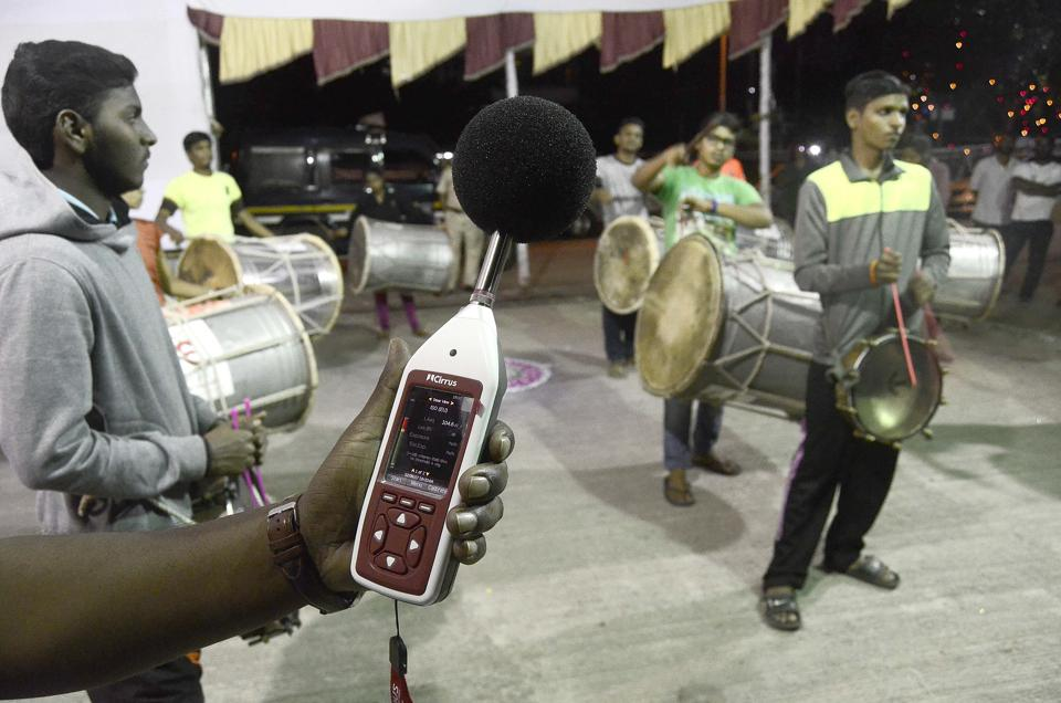 Police official check noise using a decibel meter in Pune on Saturday, September 2.