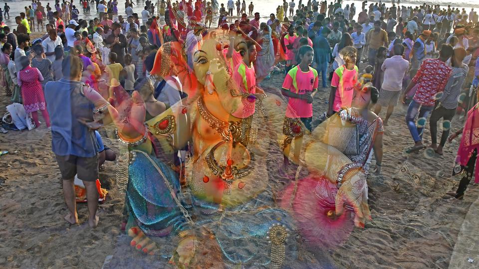 People carry Hindu God Ganesha for Immersion on 7th day at Versova Beach in Mumbai. (Shashi S Kashyap / HT PHOTO)