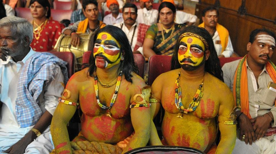 Indian artists Madan Singh Yadav (R) and Raju (L) dressed as Potharaju, brother of the Hindu goddess Maha Kali, wait to perform at the folk arts festival Janapada Jatara in Hyderabad .  (NOAH SEELAM / AFP)