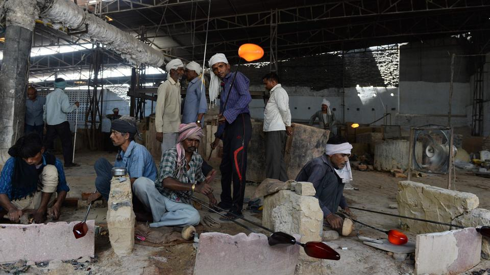 Workers at a glass factory in Firozabad. India's economic growth slipped to a three-year low of 5.7% in April-June following disruptions caused by demonetisation.