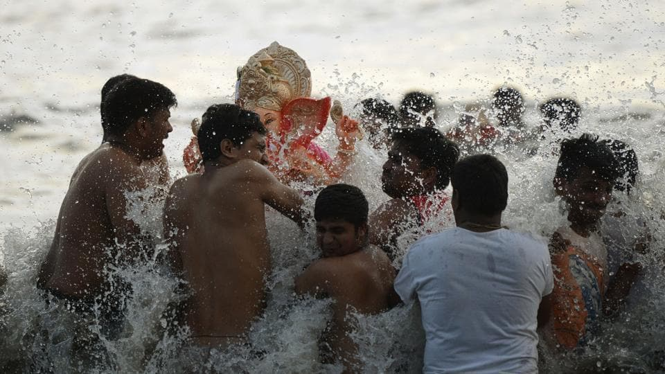 Indian Hindu devotees carry an idol of elephant-headed Hindu deity Ganesha for immersion at Dadar Chowpatty beach on the seventh day of the eleven-day long festival Ganesh Chaturthi in Mumbai. Hindu devotees bring home idols of Lord Ganesha in order to invoke his blessings for wisdom and prosperity. The eleven day Ganesh Festival sees millions of Hindus gathering along the western city's coast to immerse the elephant-god idols in the Arabian sea. (PUNIT PARANJPE / AFP)