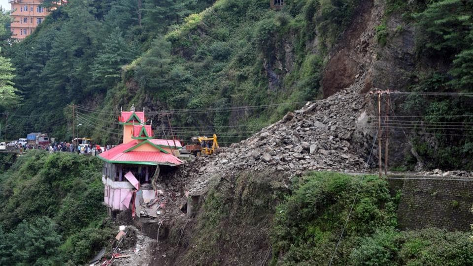Rubble blocks the Chandigarh-Shimla national highway after a landslide buried at least six vehicles next to a temple in Bhattakufer, in the Indian state of Himachal Pradesh. (AFP)