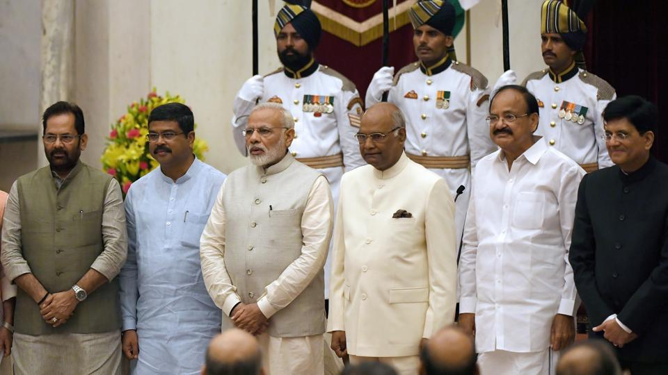 Prime Minister Narendra Modi (3rd left), President Ramnath Kovind (3rd R) and vice-president Venkiah Naidu (2nd R), pose with the newly sworn-in ministers Mukhtar Abbas Naqvi (L), Dharmendra Pradhan (2nd L) and Piyush Goyal (R) in New Delhi on Sunday.