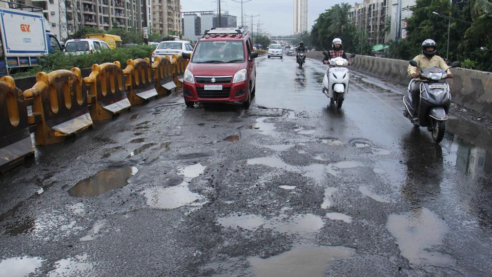 """The first """"best"""" pothole picture will get a cash award of Rs 5,000 and the second Rs 2,500."""