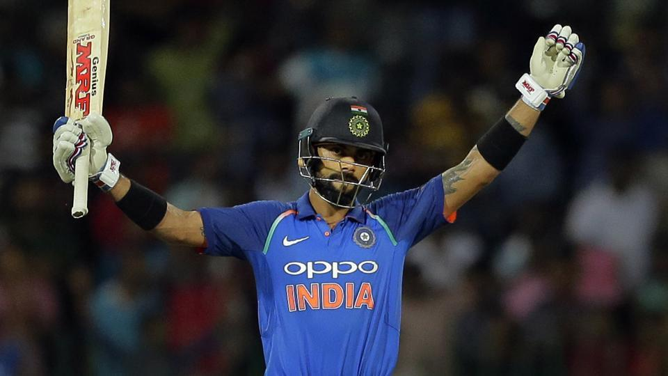 Virat Kohli, Indian cricket team captain, raises his bat after scoring a century against Sri Lanka in Colombo.