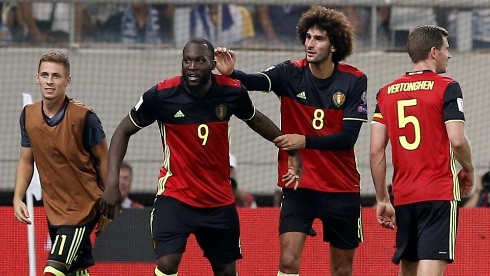Belgium's Romelu Lukaku and Marouane Fellaini celebrate a goal against Greece during the 2018 FIFA World Cup qualifier.