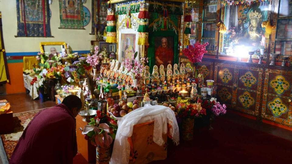 A monk paying obeisance to mummified monk Kyabjé Taklung Tsetrul Rinpoche, whose body has been preserved in a crafted wooden box, at Thubten Dorje Drak monastery, 3 km from Shimla. Rinpoche died in Bodh Gaya two years ago.