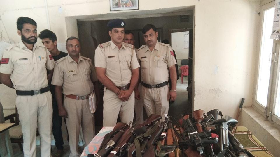 The 33 licensed weapons recovered from the Dera Sacha Sauda at Sadar police station in Sirsa on Monday.
